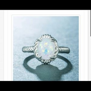 Silver oval white opal ring